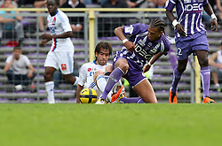 Fabian Delgado and Etienne Capoue foght for the ball. Toulouse v Lyon (2-0), Ligue 1, Stade Municipal, Toulouse, France, 1st May 2011.