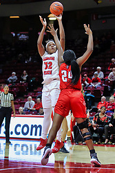 NORMAL, IL - December 04: Simone Goods shoots over Kelen Kenol during a college women's basketball game between the ISU Redbirds  and the Austin Peay Governors on December 04 2018 at Redbird Arena in Normal, IL. (Photo by Alan Look)