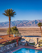 Looking out over the spring fed pool at Furnace Creek Inn to Death Valley beyond. With average temperatures in the hostest month (July) of 116.5 °F (46.9 °C) it's name is well deserved - it also holds the world record air temperature of 134 °F (56.7 °C) ...and a ground temperature of 201 °F (93.9 °C) in 1972 !!!