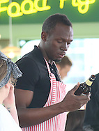 USAIN BOLT FILMS WITH JAMIE OLIVER AND JIMMY DOCHERTY ON SOUTHEND PIER THEN GETS HIS OWN PERSONALISED RAIL TRANSPORT BACK TO THE SEAFRONT.20.9.13.PIX STEVE BUTLER