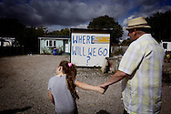 UNITED KINGDOM, Basildon :Two residents stand next a sign at Dale Farm travellers camp on September 19, 2011 in Basildon, England.  © Christian Minelli.