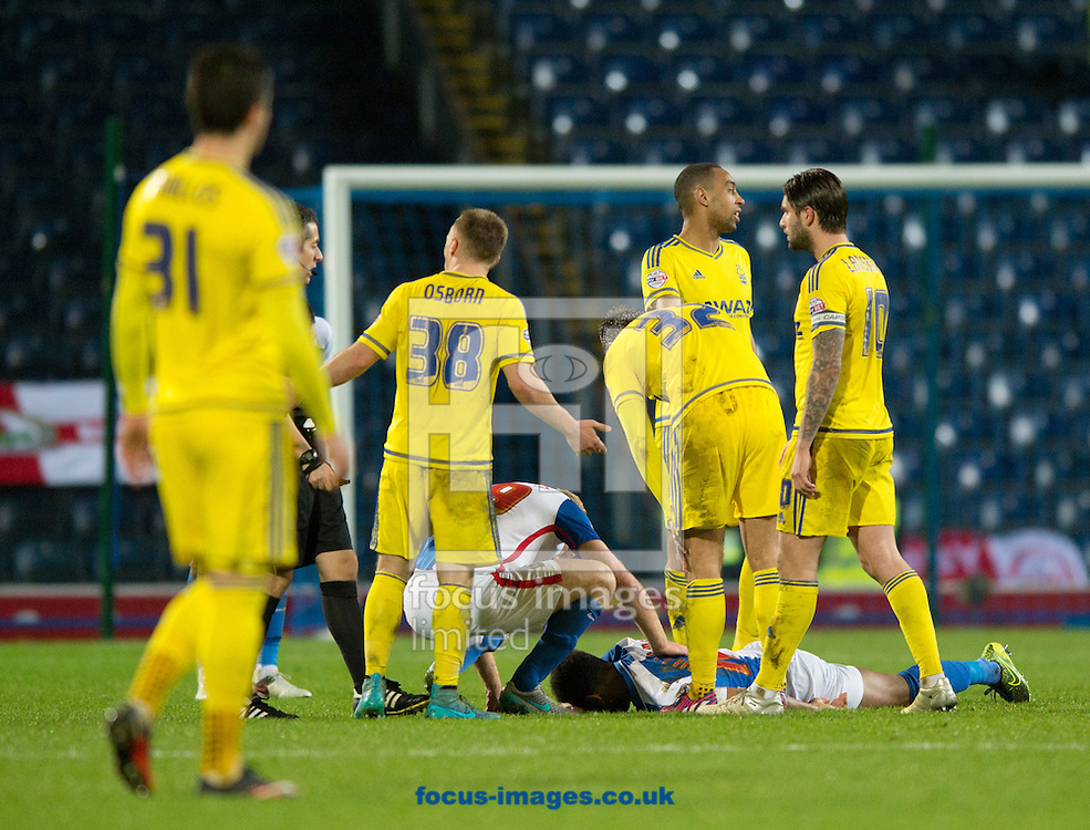 Lee Williamson of Blackburn Rovers goes down injured after a heavy landing during the Sky Bet Championship match at Ewood Park, Blackburn<br /> Picture by Russell Hart/Focus Images Ltd 07791 688 420<br /> 14/12/2015