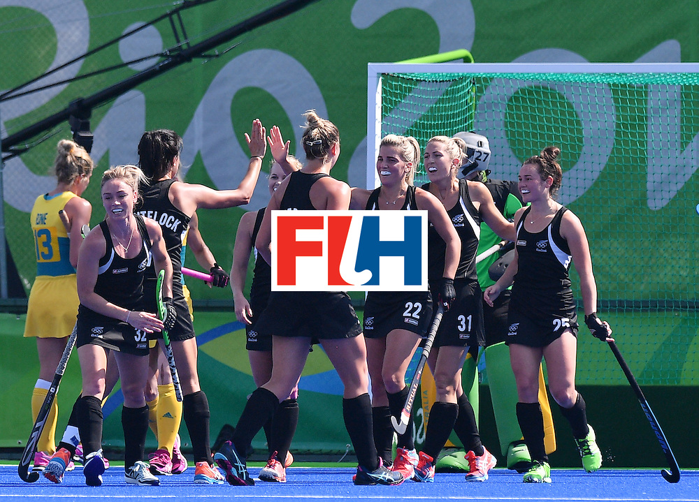 New Zealand's Kelsey Smith (R) celebrates a goal with teammates during the the women's quarterfinal field hockey New Zealand vs Australia match of the Rio 2016 Olympics Games at the Olympic Hockey Centre in Rio de Janeiro on August 15, 2016. / AFP / Carl DE SOUZA        (Photo credit should read CARL DE SOUZA/AFP/Getty Images)