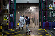 Cast member Jay Scott passes a worker at Smithfield Meat Market as he makes his way home after rehearsals.<br /> The full-scale production, which runs from 8th Nov - 2nd of Dec 2017 under Smithfield Meat Market, has been put together by charity The Big House, a charity that helps troubled youths who have been in care.