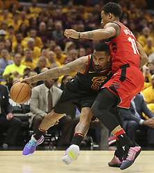 May 7, 2018 - Cleveland, OH, USA - Cleveland Cavaliers' J.R. Smith drives through Toronto Raptors' DeMar DeRozan during the first quarter in Game 4 of a second-round playoff series on Monday, May 7, 2018 in Cleveland, Ohio. (Credit Image: © Phil Masturzo/TNS via ZUMA Wire)