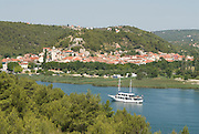 Krka Nationalpark with town and ships in the sea. Croatia. Eastern Europe.