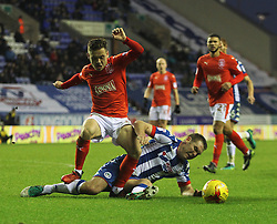 Jake Buxton of Wigan Athletic tackles Jack Payne of Huddersfield Town (L)  - Mandatory by-line: Jack Phillips/JMP - 02/01/2017 - FOOTBALL - DW Stadium - Wigan, England - Wigan Athletic v Huddersfield Town - Football League Championship