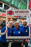Suzanne Pullinger, Chairperson Nobuzwe Mbuyiso and Duncan MacDuff at the Stop Hunger Now packaging event taking place at Century City, Cape Town on Mandela Day.