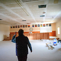 020314       Adron Gardner<br /> <br /> Chichiltah Chapter Community Services Coordinator Roselyn John walks through the unfinished chapter house in  Chichiltah Tuesday.  &quot;We can't give up.  I was born here.  This is my home,&quot; John said.