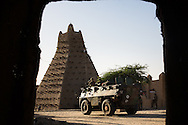 French troops patrol in fronf of the grand Mosque Timbuktu after taking the city back from Islamic militants on Jan. 30, 2013.