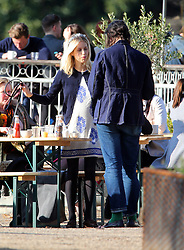 Peaches Geldof and husband Thomas Cohen back from recent trip to Disneyland in Paris, enjoying the sunshine at a park in London. Peaches was wearing a silver flower headband, beige trench coat, blue and white dress. The happy couple who are expecting their second child later this year had a spot of lunch near the pond before taking a stroll around the park with their dog Parpy... London, UK. 06/03/2013<br />