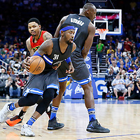 25 February 2017: Orlando Magic forward Terrence Ross (31) drives past Atlanta Hawks forward Kent Bazemore (24) on a screen set by Orlando Magic center Bismack Biyombo (11) during the Orlando Magic 105-86 victory over the Atlanta Hawks, at the Amway Center, Orlando, Florida, USA.
