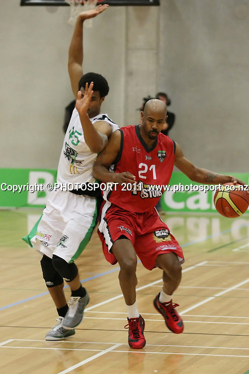 Darryl Hudson for the jets tires to block Jason Crowe of the Pistons during  their NBL Game at Hamilton,,Basketball,Pistons Vs Jets, Wednesday 22 June 2011.<br /> Photo: Dion Mellow / photosport.co.nz