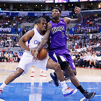 25 October 2013: Los Angeles Clippers point guard Chris Paul (3) is fouled by Sacramento Kings small forward John Salmons (5) during the Sacramento Kings 110-100 victory over the Los Angeles Clippers at the Staples Center, Los Angeles, California, USA.