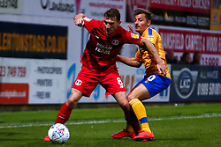 Craig Clay of Leyton Orient shields the ball from Otis Khan of Mansfield Town - Mandatory by-line: Ryan Crockett/JMP - 20/08/2019 - FOOTBALL - One Call Stadium - Mansfield, England - Mansfield Town v Leyton Orient - Sky Bet League Two