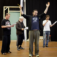 "Picture shows : Paul Riley as Fran, Jimmy Chisolm as Simon,  Greg Hemphill as Finlay and Sean Biggerstaff as Rory  during the rehearsals of the forthcoming National Theatre of Scotland production 'An Appointment with The Wicker Man'..Picture © Drew Farrell  ( Tel : 07721-735041 ).On a remote Scottish island, the Loch Parry Theatre Players mount their am-dram version of The Wicker Man. When their lead actor goes missing in mysterious circumstances, they call on the services of a television cop from the mainland to step in and save their production. ..The play opens at the MacRobert Arts Centre, Stirling on 18th February 2012 before touring Aberdeen, Glasgow, Inverness and Dunfermline...The Wicker Man regularly tops ""Best Horror Film of All Time"" lists and is regarded as a true film classic. With an unforgettable sense of creeping dread, a wonderfully memorable score by Paul Giovanni, career defining performances from Edward Woodward and Christopher Lee it also has arguably the best ending in cinema history. Now, in an affectionate new adaptation, the National Theatre of Scotland gives a gallus round of applause to this immortal chronicle of strange goings-on in a wee village. 