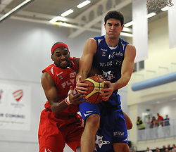 Bristol Flyers' Siman Stewart challenges for the ball with  Durham Wildcats' John Puk - Photo mandatory by-line: Dougie Allward/JMP - Mobile: 07966 386802 - 18/10/2014 - SPORT - Basketball - Bristol - SGS Wise Campus - Bristol Flyers v Durham Wildcats - British Basketball League