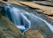 Cool water flows over the contoured rocks of Nevada Falls.
