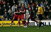 Dominic Matteo (centre) celebrates his penalty goal for Stoke City
