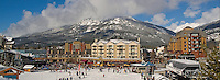 Whistler Village on a sunny winter day welcomes skiers from the mountain.