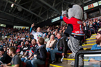 KELOWNA, CANADA - APRIL 7:  The dancing  man fan and Kelowna Rockets' mascot Rocky Racoon ham it up in the crowd against the Portland Winterhawks on April 7, 2017 at Prospera Place in Kelowna, British Columbia, Canada.  (Photo by Marissa Baecker/Shoot the Breeze)  *** Local Caption ***