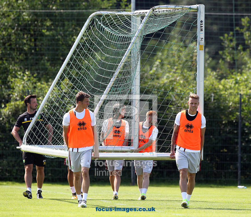 Christoph Zimmermann of Norwich, James Maddison of Norwich, Harrison Reed of Norwich and Marcel Franke of Norwich help move a set of goalposts during the Norwich City Pre-Season Training session at Hotel Klosterpforte, Harsewinkel, Germany<br /> Picture by Paul Chesterton/Focus Images Ltd +44 7904 640267<br /> 18/07/2017