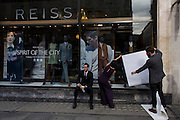Employees from mens' clothing retailer Reiss, put up a poster in the window of their store in London's Regent St..Since its foundation by David Reiss in 1971, Reiss has established a design philosophy centred on creating directional, design-led menswear, womenswear and accessories. With an uncompromising commitment to delivering innovative and original products it fuses exceptional design, quality and value. Today Reiss is a highly respected, prominent business in the global fashion arena for both men and women.