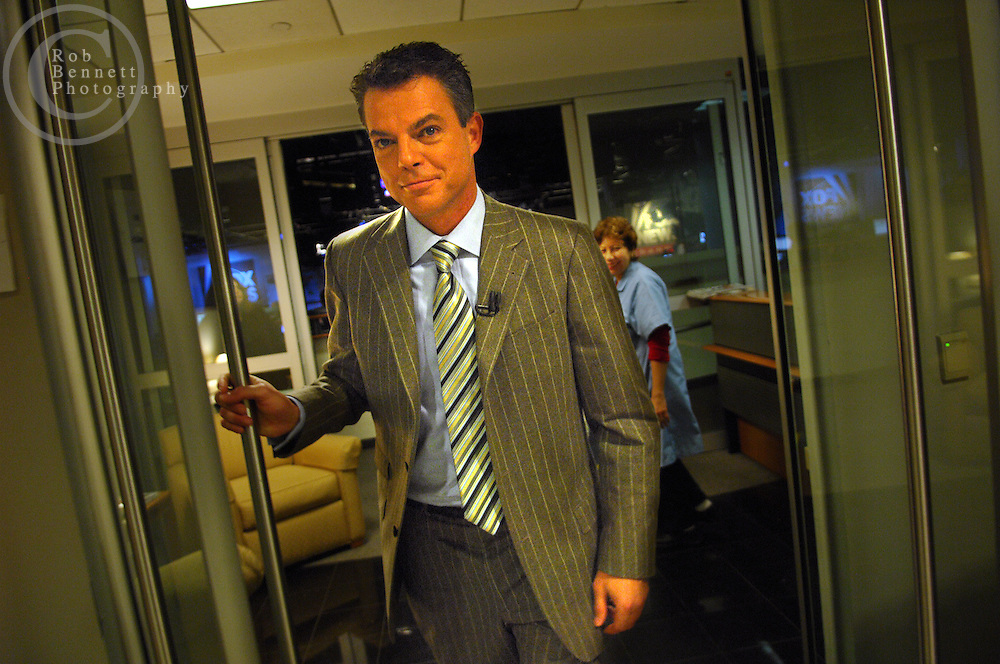"""Here, Smith exits the newsroom en route to the studio..---.New York, NY - Thursday, Nov. 15, 2007 - Shepard Smith, anchor of the Fox News program """"The Fox Report With Shepard Smith."""" Program airs from 7 to 8 PM....Rob Bennett for The New York Times"""