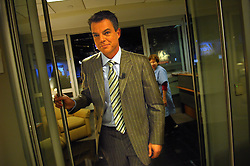 "Here, Smith exits the newsroom en route to the studio..---.New York, NY - Thursday, Nov. 15, 2007 - Shepard Smith, anchor of the Fox News program ""The Fox Report With Shepard Smith."" Program airs from 7 to 8 PM....Rob Bennett for The New York Times"