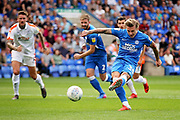Peterborough United forward Jason Cummings (35) scores his first goal from the penalty spot during the EFL Sky Bet League 1 match between Peterborough United and Luton Town at London Road, Peterborough, England on 18 August 2018.