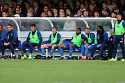 AFC Wimbledon Jack Madelin (31) sat on the bench during the EFL Sky Bet League 1 match between AFC Wimbledon and Portsmouth at the Cherry Red Records Stadium, Kingston, England on 19 October 2019.