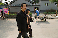 Jeffrey Huang(L) designer, architect and director of the Media and Design Laboratory photographed with Muriel Waldvogel visual designer and architect. Together they run Convergeo.com. Photographed in Beijing during Synthetic Times exhibition.
