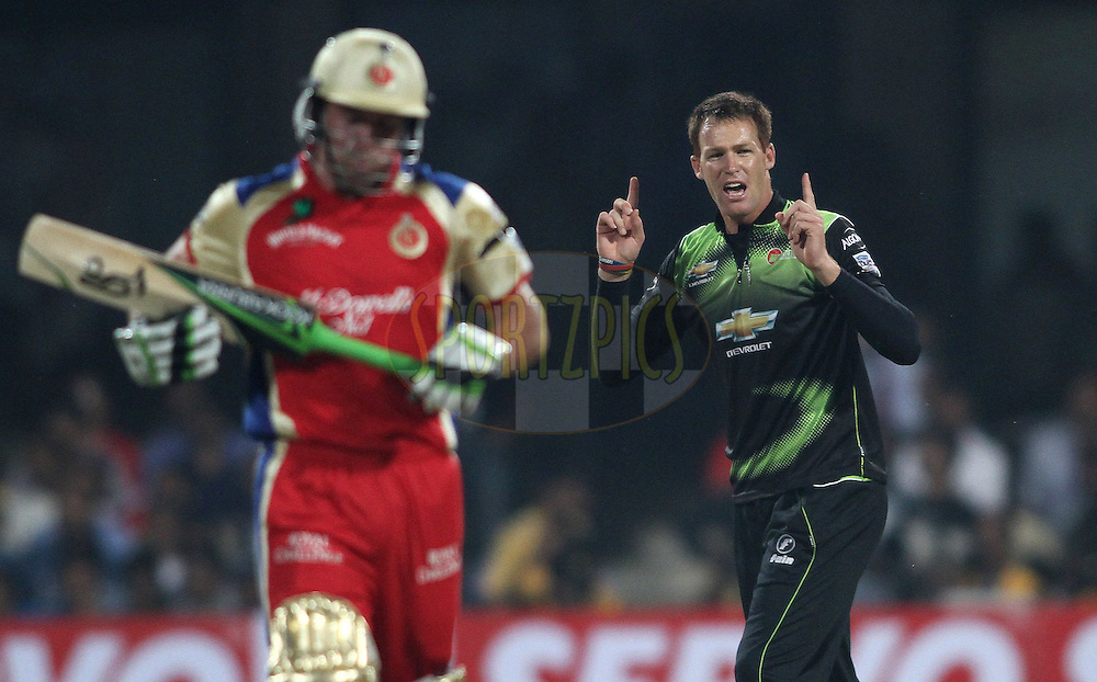 Juan Rusty Theron of the Warriors celebrates Virat Kohli of Royal Challengers Bangalore wicket  during match 1 of the NOKIA Champions League T20 ( CLT20 )between the Royal Challengers Bangalore and the Warriors held at the  M.Chinnaswamy Stadium in Bangalore , Karnataka, India on the 23rd September 2011..Photo by Shaun Roy/BCCI/SPORTZPICS