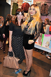 Left to right, OPHELIA LOVIBOND and ZARA MARTIN at a party to celebrate the launch of Louise Gray's make-up and clothing collections for Topshop held at Topshop Edited, 286 Regent Street, London on 22nd August 2012.