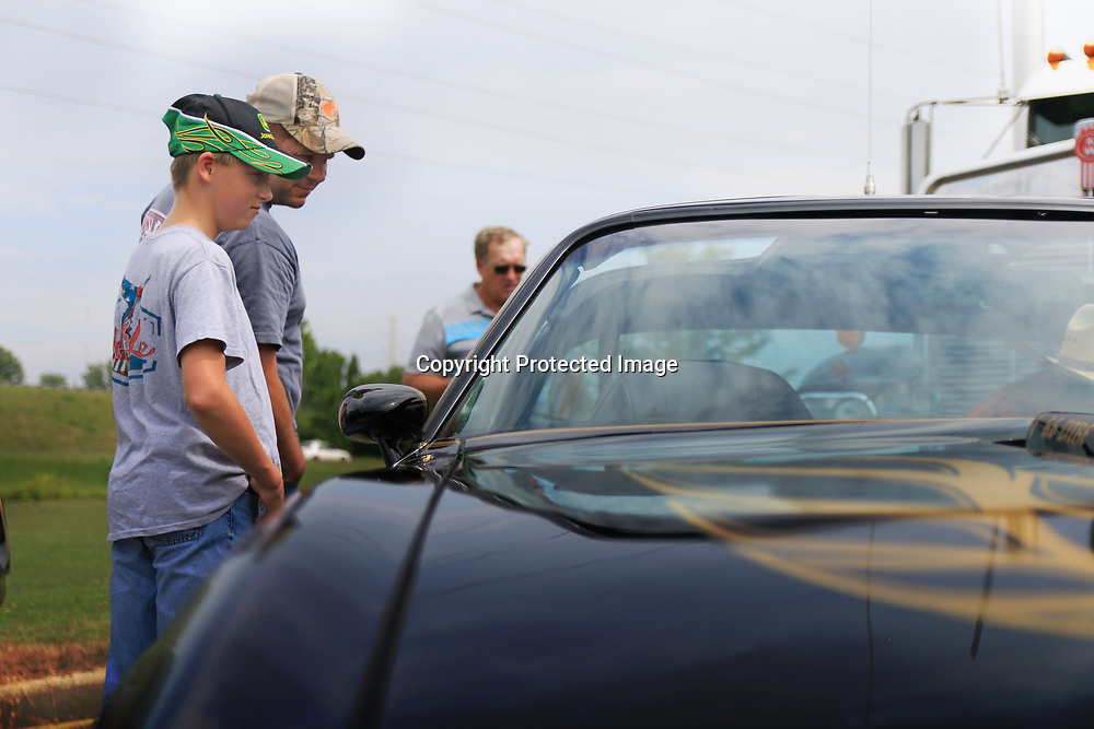 Dwayne Ming and his son Toby check out Burt Reynold's personal Pontiac Trans Am during The Bandit Run at the Tupelo Automobile Museum.