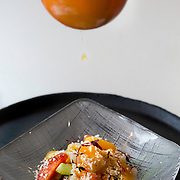 """French orange is squeezed onto he """"Gaspacho"""" estilo Morelia, a salad of jicama root, mango, cucumbers, jalapeños, queso fresco and Mexican sour orange at Oyamel, in downtown Washington, DC."""