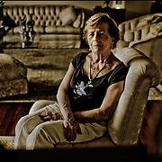 PORTRAITS OF SURVIVORS AND IMMIGRANTS <br /> Sobreviviente del Holocausto / Holocaust Survivor.<br /> <br /> Sra. Ana Reisch de Bubis.<br /> <br /> Nació el 23 de abril de 1933 en Czernowitz, Rumania. Al comenzar la guerra y formarse el gueto, fue llevada con su familia, emprendiendo un recorrido que los llevaría en medio de incontables infortunios a campos de trabajo de Otaci, Mogilev, Skazenetz y Tivriv. Para poder volver a Rumania, su madre declaró que ella y su hermana eran huérfanas. El padre murió de tifus. Volvió a Czernowitz y al terminar la guerra se reencontró con su madre. En 1948, tras una temporada en Chipre, llegó a Israel, donde conoció a su esposo, Yehuda Bubis, con quien se instala en Venezuela en 1953.<br /> <br /> Photography by Aaron Sosa<br /> Caracas - Venezuela 2009<br /> (Copyright © Aaron Sosa)