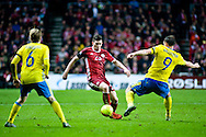 17.11.2015. Copenhagen, Denmark. <br /> Pierre Højbjerg (L) of Denmark fights for the ball with Kim Kallstrom (R) of Sweden during their UEFA EURO 2016 play-off second leg match at the Telia Parken Stadium. <br /> Photo: © Ricardo Ramirez.