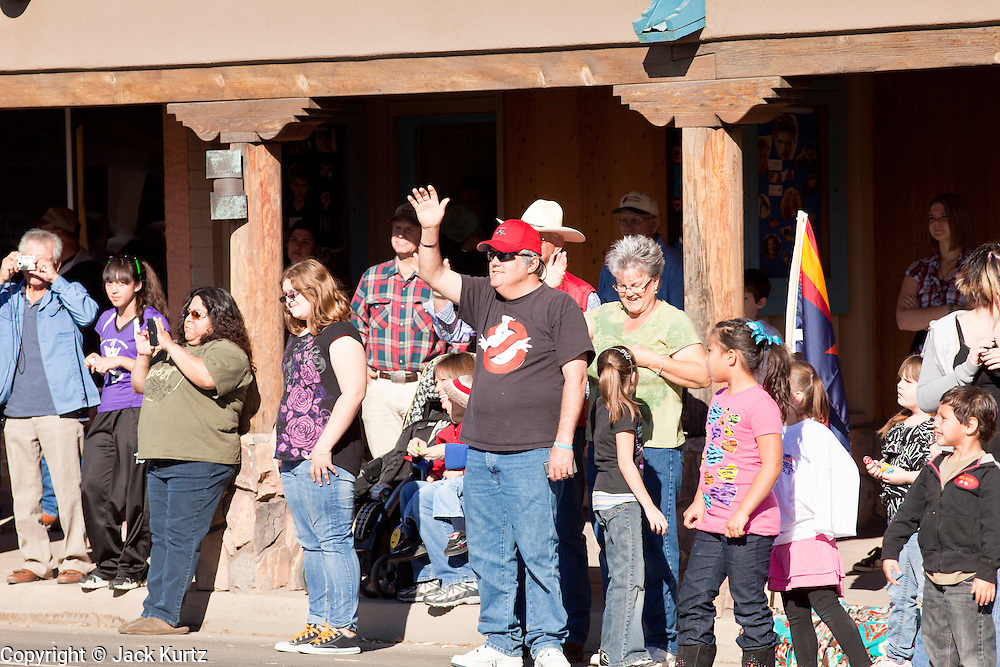 28 JANUARY 2012 - BUCKEYE, AZ:    Spectators watch the Buckeye Days parade. The Buckeye Days parade went through downtown Buckeye, AZ, an agricultural community about 45 miles west of Phoenix. The parade was one the first events to mark Arizona's centennial celebration. Arizona was admitted to the United States on Feb 14, 1912, making it the 48th state in the union. The state celebrates its 100th birthday with a series of events on Feb. 14, 2012.     PHOTO BY JACK KURTZ
