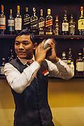 Bartender at Raffles Grand Hotel d'Angkor, Siem Reap