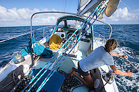 Patagonia ambassador Liz Clark trimming her sails. French Polynesia