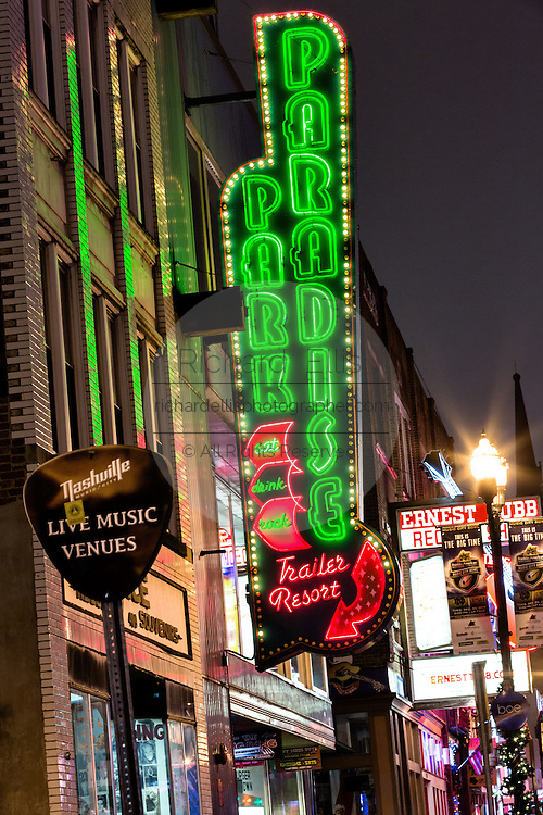 Neon sign for Paradise Park and other honky tonks on lower Broadway in Nashville, TN.
