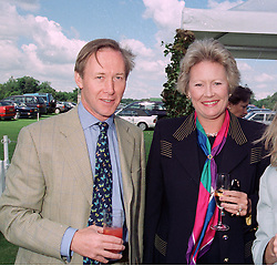 LORD & LADY DULVERTON at a polo match in Cirencester on 6th July 1997.<br /> LZZ 65 2OLO