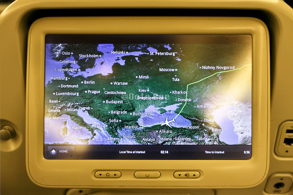 flight plan tracking on back of airplane seat screen flying  around Ukraine and Donetsk