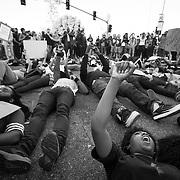 "Protesters on the streets of Los Angeles demonstrating against the decision in Ferguson, Missouri to not indict police officer in the shooting death of unarmed, black teenager Mike Brown. Protesters laid down for 4 1/2 minutes in tribute to Mike Brown laying dead for 4 1/2 hours in the streets. These Photographs And More Are Available in Color. Please Search for ""Ferguson"""