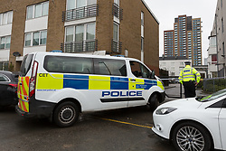 © Licensed to London News Pictures. 02/04/2018. London, UK. A police van and police officers at the crime scene on the estate behind a parade of shops on the A12 in Bromley by Bow, E3 where a teenager was stabbed last night at around 6:05pm. A 16 year old boy suffering stabbing injuries and also a further victim were taken to an east London hospital by London Ambulance staff. The teenage victim remains in a critical condition this morning. Photo credit: Vickie Flores/LNP