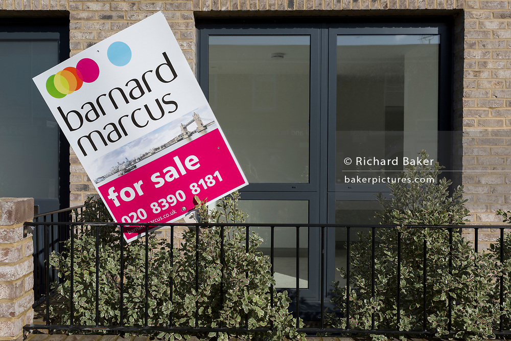 A placard belonging to estate agent Barnard Marcus, in front of a property for sale in south-west London, on 7th November 2019, in Surbiton, London, England