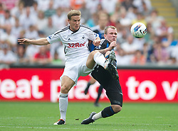 SWANSEA, WALES - Sunday, October 2, 2011: Swansea City's Mark Gower in action against Stoke City's Glenn Whelan during the Premiership match at the Liberty Stadium. (Pic by David Rawcliffe/Propaganda)