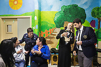 LECCE, ITALY - 10 NOVEMBER 2016: (R-L) Trained sommeliers Marco Albanese and Roberto Giannone consult each other while female inamtes chat with a prison guard during a lecture on the arts and crafts of wine tasting and serving, in the largest penitentiary in the southern Italian region of Apulia, holding 1,004 inmates in the outskirts of Lecce, Italy, on November 10th 2016.<br /> <br /> Here a group of ten high-security female inmates and aspiring sommeliers , some of which are married to mafia mobsters or have been convicted for criminal association (crimes carrying up to to decades of jail time), are taking a course of eight lessons to learn how to taste, choose and serve local wines.<br /> <br /> The classes are part of a wide-ranging educational program to teach inmates new professional skills, as well as help them develop a bond with the region they live in.<br /> <br /> Since the 1970s, Italian norms have been providing for reeducation and a personalized approach to detention. However, the lack of funds to rehabilitate inmates, alongside the chronic overcrowding of Italian prisons, have created a reality of thousands of incarcerated men and women with little to do all day long. Especially those with a serious criminal record, experts said, need dedicated therapy and professionals who can help them.