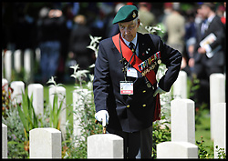 Image ©Licensed to i-Images Picture Agency. 06/06/2014. Bayeux, France, A Veteran looks at graves as HM The Queen and The Duke of Edinburgh accompanied by The Prince of Wales and The Duchess of Cornwall attend a service of Remembrance at the Commonwealth War Graves Cemetery at Bayeux, Normandy, France,  on the 70th anniversary of D-Day.  Picture by Andrew Parsons / i-Images